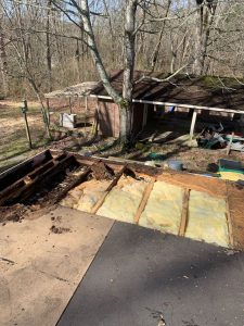 Photo of roof damage caused by improper roof installation